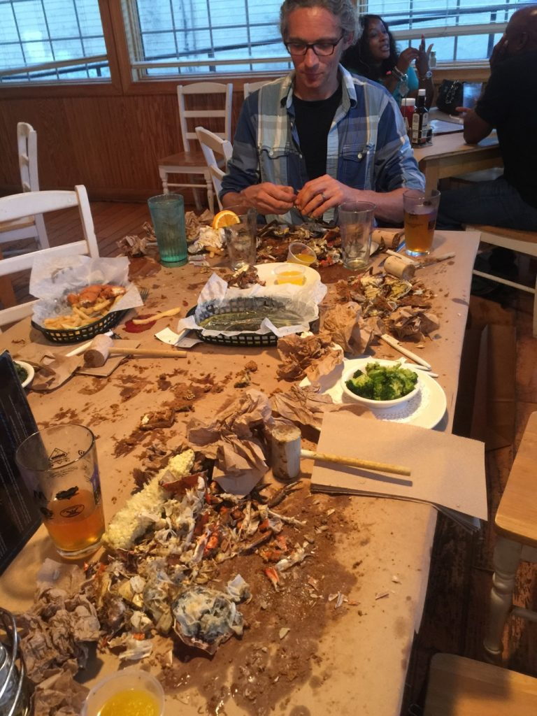 Drummer at the head of the table full of empty crab shells