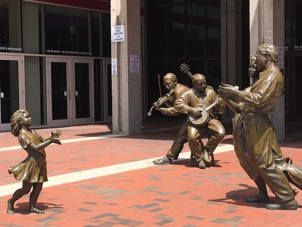 Statues of dancing girl and bluegrass players