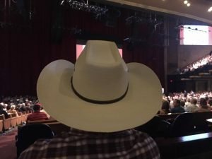 Grand Ole Opry view obstructed by cowboy hat