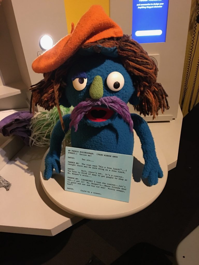 Muppet character with long hair and a beret